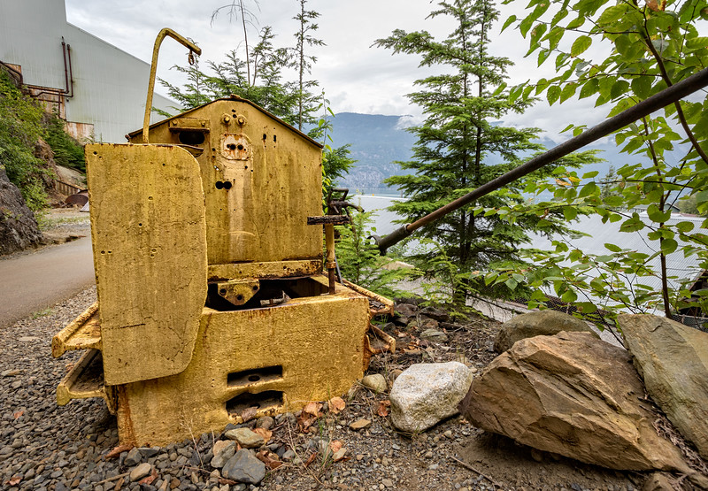Some kind of machine on display with the BC mountains in the background.
