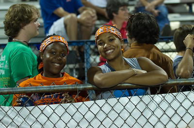 Fans and Volunteers at the game working Hard and cheering their school on. Family Portraits