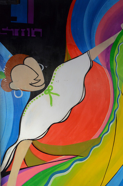 Wall paintings like this dancer can be found along the streets on many buildings in San Jose