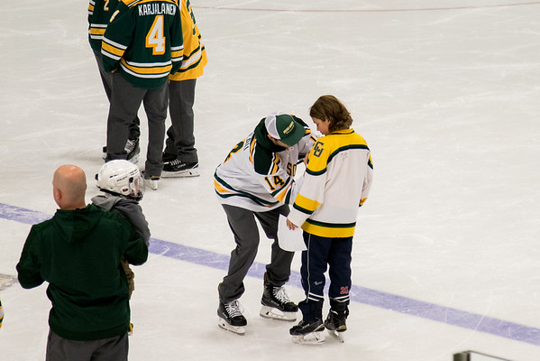 Clarkson Athletics: Men Hockey skate with a knight