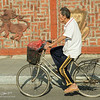 Mural and whistling man on bike, Saigon-6887