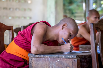Buddhist monk at study.