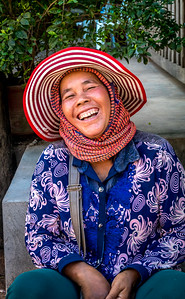 Happy vendor in a market.