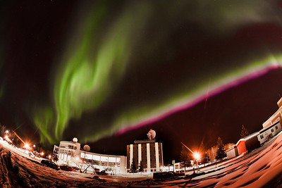 The aurora borealis dances across the night sky above the International Arctic Center Research and the Elvey Building on UAF's West Ridge.  Filename: CAM-12-3324-24.jpg