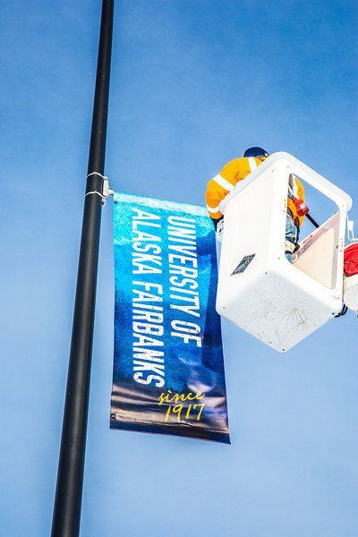 "A crew from UAF's Facilities Services monts new banners at various locations on the Fairbanks campus.  <div class=""ss-paypal-button"">Filename: CAM-13-3722-1.jpg</div><div class=""ss-paypal-button-end"" style=""""></div>"
