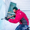 "Ronald Daanen, a research assistant professor with UAF's Institute of Northern Engineering, puts some finishing touches on an ice carving of a hibernating bear in front of the University of Alaska Museum of the North Monday afternoon.  <div class=""ss-paypal-button"">Filename: CAM-13-3701-14.jpg</div><div class=""ss-paypal-button-end"" style=""""></div>"