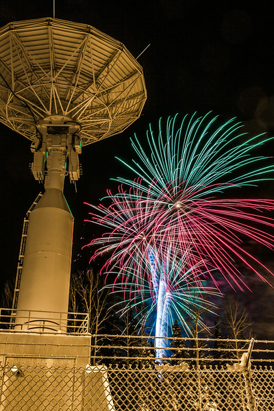 "Fireworks illuminate the Alaska Satellite Facility's 11-meter antenna on West Ridge during the annual New Year's Eve Sparktacular.  <div class=""ss-paypal-button"">Filename: CAM-13-4028-50.jpg</div><div class=""ss-paypal-button-end""></div>"