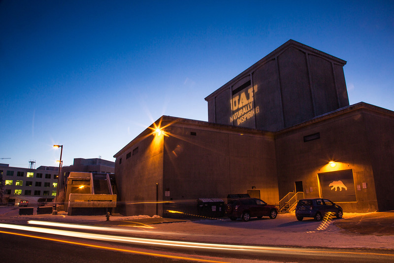 """The tagline """"Naturally Inspiring"""" is illuminated on the outside wall of UAF's Salisbury Theatre on a cold winter evening.  <div class=""""ss-paypal-button"""">Filename: CAM-12-3678-14.jpg</div><div class=""""ss-paypal-button-end"""" style=""""""""></div>"""