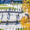 "Students walk through the circle of flags in Cornerstone Plaza on the Fairbanks campus.  <div class=""ss-paypal-button"">Filename: CAM-12-3541-55.jpg</div><div class=""ss-paypal-button-end"" style=""""></div>"