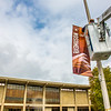 "A facilities crew member hangs a new location banner near the Rasmuson Library on the Fairbanks campus.  <div class=""ss-paypal-button"">Filename: CAM-13-3920-11.jpg</div><div class=""ss-paypal-button-end"" style=""""></div>"
