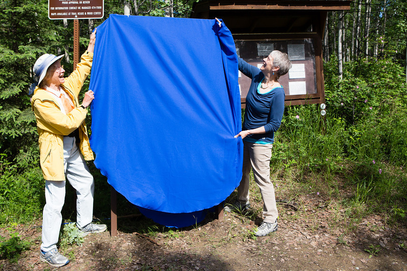 "Teri Viereck, left, and Sherry Modrow, unveil the Les Viereck Nature Trail marker during the dedication ceremony of the trail.  <div class=""ss-paypal-button"">Filename: CAM-12-3435-46.jpg</div><div class=""ss-paypal-button-end"" style=""""></div>"