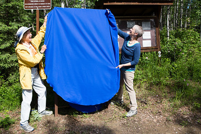 Teri Viereck, left, and Sherry Modrow, unveil the Les Viereck Nature Trail marker during the dedication ceremony of the trail.  Filename: CAM-12-3435-46.jpg