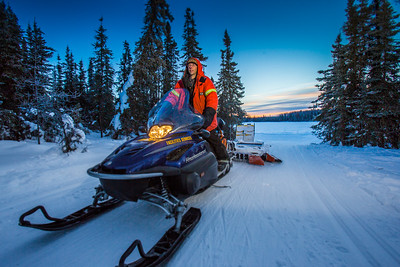 Ski trails manager Jason Garron grooms the skate ski track on the UAF trails early on a cold February morning.  Filename: CAM-16-4818-52.jpg
