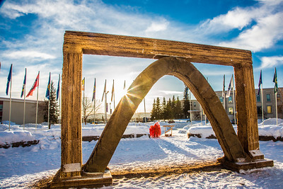 The 2013 ice arch, designed and built on the Fairbanks campus each spring by engineering students, was constructed of pykrete - a combination of water and sawdust.  Filename: CAM-13-3756-8.jpg