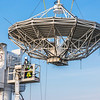 """A crew from Texas helps install an 11-meter antenna operated by UAF's Alaska Satellite Facility at its location on West Ridge. Once fully operational, the dish will gather data from spacecraft about land surface, biosphere, atmosphere, oceans and outer space. It's one of several strategically placed antennas that can capture data from polar-orbiting satellites several times per day.  <div class=""""ss-paypal-button"""">Filename: CAM-13-3903-036.jpg</div><div class=""""ss-paypal-button-end"""" style=""""""""></div>"""