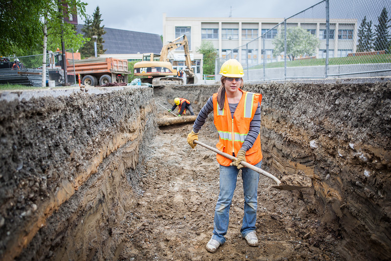 "Summer construction worker Randee Metayer stops for a portrait after showing remains from what was once known as Main Dorm were unearthed during summer 2013 construction work in June.  <div class=""ss-paypal-button"">Filename: CAM-13-3854-39.jpg</div><div class=""ss-paypal-button-end"" style=""""></div>"