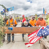 "Iron workers with Davis Constructors sign their names on the final steel beam before it's lifted into position in UAF's new engineering facility following a brief ceremony May 22. The final piece of steel is topped with Alaska and U.S. flags and, following an ancient  Scandinavian tradition, a small tree.  <div class=""ss-paypal-button"">Filename: CAM-14-4199-79.jpg</div><div class=""ss-paypal-button-end""></div>"