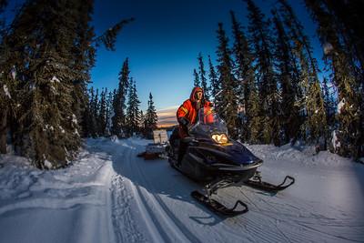 Ski trails manager Jason Garron grooms the skate ski track on the UAF trails early on a cold February morning.  Filename: CAM-16-4818-67.jpg