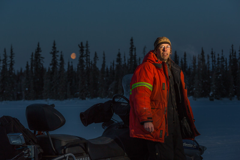 """Ski trails manager Jason Garron takes a break on frozen Smith Lake while grooming the skate ski track on the UAF trails early on a cold February morning.  <div class=""""ss-paypal-button"""">Filename: CAM-16-4818-39.jpg</div><div class=""""ss-paypal-button-end""""></div>"""