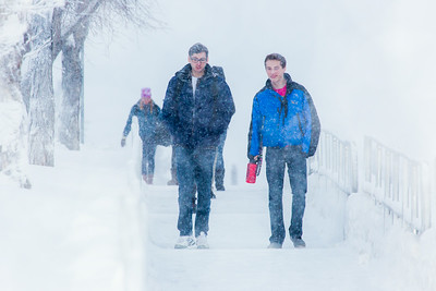 Students make their way around the Fairbanks campus through some freshly fallen snow on the first day of classes in the Spring 2014 semester.  Filename: CAM-14-4038-46.jpg