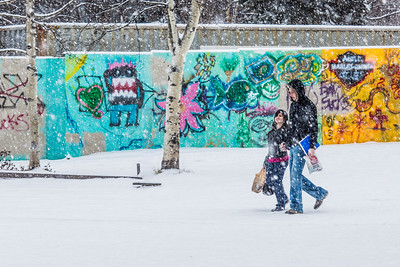 Students leave Wood Center to walk across campus on a snowy November afternoon.  Filename: CAM-13-3993-31.jpg