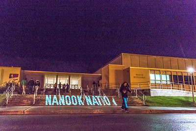 Student volunteers walk in and out of the Patty Center during a late night promotional multi-media production introducing the Nanook Nation theme.  Filename: CAM-13-3925-134.jpg