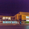 "Student volunteers walk in and out of the Patty Center during a late night promotional multi-media production introducing the Nanook Nation theme.  <div class=""ss-paypal-button"">Filename: CAM-13-3925-134.jpg</div><div class=""ss-paypal-button-end"" style=""""></div>"