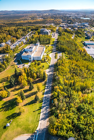 An aerial view above Yukon Drive on the UAF campus looking east toward Fairbanks at about 11:25 a.m. on Sept. 10, 2016.  Filename: CAM-16-4992-121.jpg