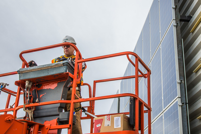 """Jeff Montgomery with Industrial Electric works on connecting new solar panels on the SRC into the building's electrical system.  <div class=""""ss-paypal-button"""">Filename: CAM-12-3568-44.jpg</div><div class=""""ss-paypal-button-end"""" style=""""""""></div>"""