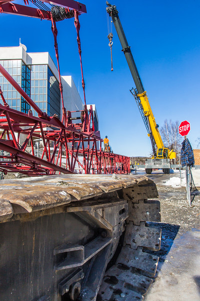 """Workers assemble the pieces of a 220-foot crane used to install steel beams on the new expansion of the Duckering Building.  <div class=""""ss-paypal-button"""">Filename: CAM-14-4122-12.jpg</div><div class=""""ss-paypal-button-end"""" style=""""""""></div>"""