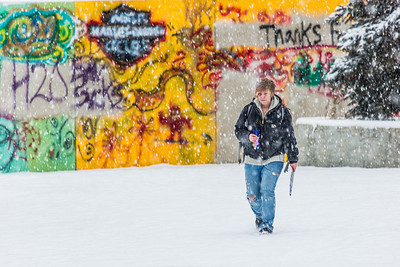 Emily Smola walks across campus on a snowy November afternoon.  Filename: CAM-13-3993-27.jpg