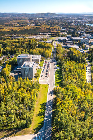 An aerial view above Yukon Drive on the UAF campus looking east toward Fairbanks at about 11:25 a.m. on Sept. 10, 2016.  Filename: CAM-16-4992-125.jpg