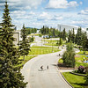 """Pedestrians cross Yukon Drive from the Elvey Building on Troth Yeddha' during a sunny, mid-June afternoon. This view is from the Akasofu building looking east toward campus.  <div class=""""ss-paypal-button"""">Filename: CAM-16-4917-123.jpg</div><div class=""""ss-paypal-button-end""""></div>"""