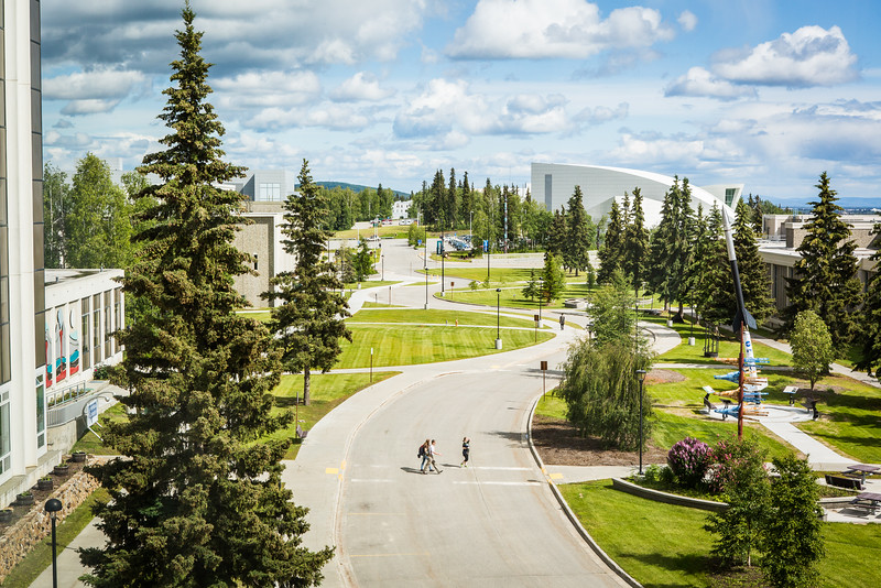"Pedestrians cross Yukon Drive from the Elvey Building on Troth Yeddha' during a sunny, mid-June afternoon. This view is from the Akasofu building looking east toward campus.  <div class=""ss-paypal-button"">Filename: CAM-16-4917-123.jpg</div><div class=""ss-paypal-button-end""></div>"