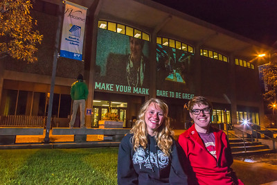 Undergraduates Teal Rogers and Jimmy Donohue pose during a late night promotional video shoot  by the Rasmuson Library.  Filename: CAM-13-3925-202.jpg