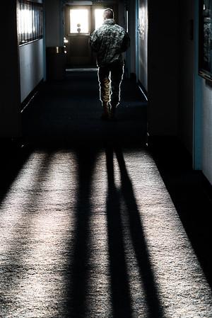 A low angled December sun shines through an Eielson Building doorway.  Filename: CAM-15-4749-10.jpg