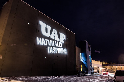 "The ""Naturally Inspiring"" tagline is projected on the outside wall of the Student Recreation Center.  Filename: CAM-12-3647-5.jpg"