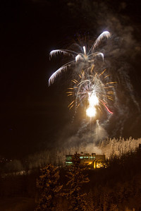Fireworks light up the sky above UAF's West Ridge during the annual New Year's Eve Sparktacular. The event is organized by Mike Thomas, owner of University Chevron, and is sponsored by a group of Fairbanks community groups and businesses listed at this link: http://www.uafnews.com/headlines/community-invited-to-sparktacular-celebration.  Filename: CAM-11-3251-15.jpg