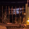 """A full moon rises over the UAF campus in late December.  <div class=""""ss-paypal-button"""">Filename: CAM-12-3686-18.jpg</div><div class=""""ss-paypal-button-end"""" style=""""""""></div>"""