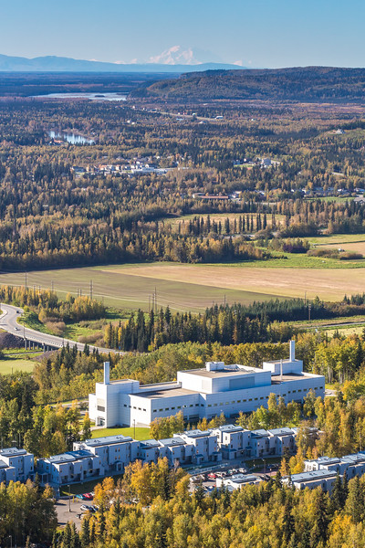 """Denali is seen on the horizon behind the Reichardt Building on the UAF campus in the foreground in an aerial photograph taken about 11:20 on Sept. 10, 2016.  <div class=""""ss-paypal-button"""">Filename: CAM-16-4992-084.jpg</div><div class=""""ss-paypal-button-end""""></div>"""