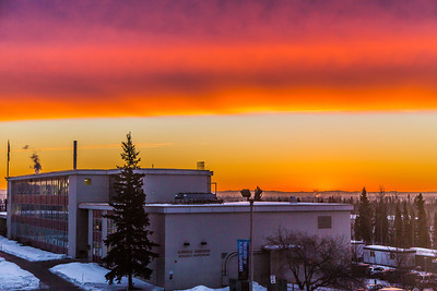 A brilliant sunrise brightens the sky southeast of the Bunnell Building on the Fairbanks campus at about 9:15 a.m. on Wednesday, Feb. 5.  Filename: CAM-14-4061-1.jpg