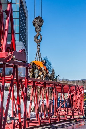 "Workers assemble the pieces of a 220-foot crane used to install steel beams on the new expansion of the Duckering Building.  <div class=""ss-paypal-button"">Filename: CAM-14-4122-16.jpg</div><div class=""ss-paypal-button-end"" style=""""></div>"