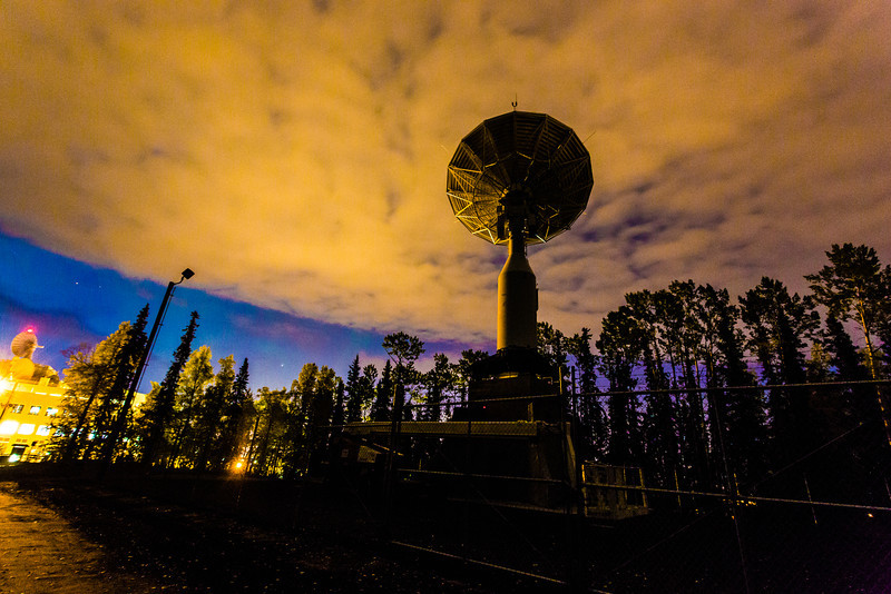"Dawn breaks in the eastern sky beyond the newly installed 11-antenna operated by UAF's Alaska Satellite Facility. Once fully operational, the dish will gather data from spacecraft about land surface, biosphere, atmosphere, oceans and outer space. It's one of several strategically placed antennas that can capture data from polar-orbiting satellites several times per day.  <div class=""ss-paypal-button"">Filename: CAM-13-3940-18.jpg</div><div class=""ss-paypal-button-end"" style=""""></div>"