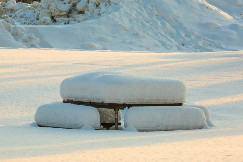 "A picnic table waits for warmer temperatures during a January afternoon on the Fairbanks campus.  <div class=""ss-paypal-button"">Filename: CAM-14-4039-1.jpg</div><div class=""ss-paypal-button-end""></div>"