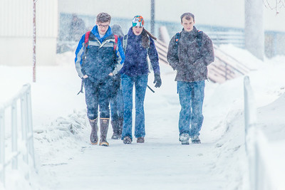 Students make their way around the Fairbanks campus through some freshly fallen snow on the first day of classes in the Spring 2014 semester.  Filename: CAM-14-4038-68.jpg