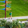 "A pedestrian makes his way past the distinctive milepost sign on UAF's West Ridge.  <div class=""ss-paypal-button"">Filename: CAM-12-3505-10.jpg</div><div class=""ss-paypal-button-end"" style=""""></div>"