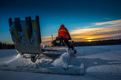 Ski trails manager Jason Garron grooms the skate ski track on the UAF trails early on a cold February morning.  Filename: CAM-16-4818-76.jpg