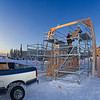 "Engineering majors Steve Lee, left, and Andy Chamberlain load pieces of the framework onto scaffolding in preparation for construction of the 2012 ice arch going up in Cornerstone Plaza.  <div class=""ss-paypal-button"">Filename: CAM-12-3261-49.jpg</div><div class=""ss-paypal-button-end"" style=""""></div>"