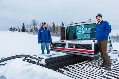 Erik Ofelt, left, and Mark Oldmixon stand by the newly donated snow groomer they'll use to keep UAF's terrain park in good condition during the winter months.  Filename: CAM-14-4030-8.jpg