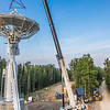 "A crew from Texas helps install an 11-meter antenna operated by UAF's Alaska Satellite Facility at its location on West Ridge. Once fully operational, the dish will gather data from spacecraft about land surface, biosphere, atmosphere, oceans and outer space. It's one of several strategically placed antennas that can capture data from polar-orbiting satellites several times per day.  <div class=""ss-paypal-button"">Filename: CAM-13-3903-061.jpg</div><div class=""ss-paypal-button-end"" style=""""></div>"
